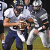 (Brad Davis/The Register-Herald) Nicholas County quarterback Jared Sagraves looks downfield as he's flushed from the pocket by Westside defender Ben Price Friday night in Clear Fork.