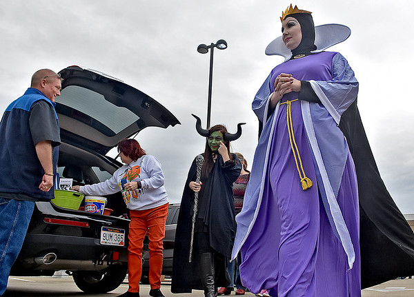 (Brad Davis/The Register-Herald) Creepy characters of all ages we spotted wandering the scene during Tailgate Halloween Saturday afternoon atop Beckley's Intermodal Gateway.