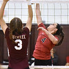 (Brad Davis/The Register-Herald) PikeView's Hope Craft goes for a spike as Woodrow Wilson's (JV) Faylin Lilly tries to block it during the Shirley Brown Invitational Volleyball Tournament Saturday afternoon at Woodrow Wilson High School.