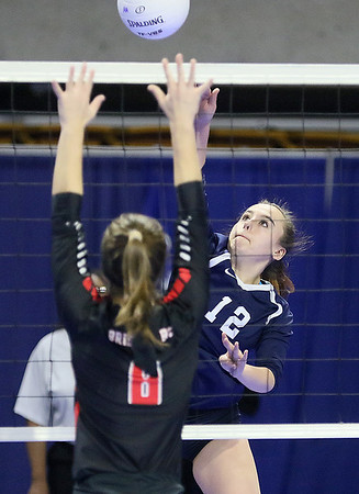 (Brad Davis/The Register-Herald) Shady Spring's Mercedes Bloomfield spikes the ball past Bridgeport's Juliet Hart during State Volleyball Tournament action Friday morning at the Charleston Civic Center.