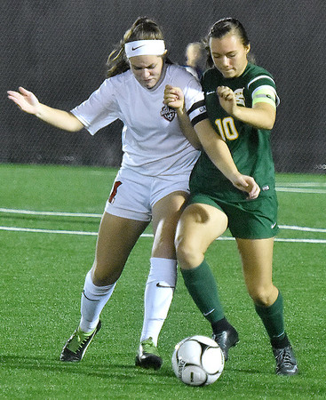 (Brad Davis/The Register-Herald) Greenbrier East's Abbie Bartenslager battles for possession with Cabell Midland's Kaylee Johnson during Class AAA Girls State Soccer Tournament action Friday night the YMCA Paul Cline Memorial Sports Complex.