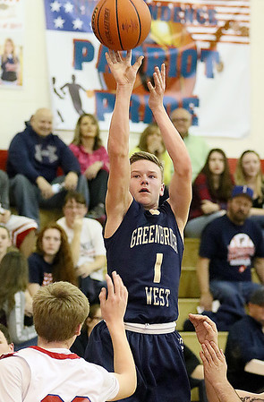 (Brad Davis/The Register-Herald) Greenbrier West's Noah Midkiff pulls up for a jump shot as Independence's Nick Kostenko defends Wednesday night in Coal City.