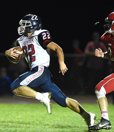 Robbie Cochran, left of Independence, catches a paas and ran for a touchdown with 1:33 left in  the second quarter against  Liberty Friday night at Liberty High School.<br /> (Rick Barbero/The Register-Herald)