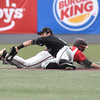 (Brad Davis/The Register-Herald) Greater Beckley Christian's David Wilson just makes it back to second in time as Charleston Catholic infielder Michael Martin has to reach out of his way to catch the catcher's pickoff attempt Thursday afternoon at Linda K. Epling Stadium.