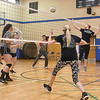 (Brad Davis/The Register-Herald) Team William, left, from Wyoming County, takes on the Beckley area's Team Half n' Half during a Volleyball 4 Autism fundraising event at Memorial Baptist Church Saturday morning. Several co-ed teams from all over the area hits the courts to help raise money for Un-Prescription, a non-profit organization that works to educate autism families and healthcare professionals about the invisible challenges of the autism spectrum.