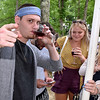 (Brad Davis/The Register-Herald) Wine enthusiast Chase Connor notices the camera and gestures as he and friends (from left) Tod Williams (hidden behind Connor), Sarah Houck and Amber Lilly sample some of Daniel Vineyards' own offerings during the winery's 19th Annual Spring Wine Festival Saturday afternoon in Crab Orchard.