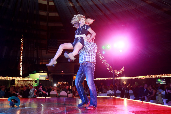 Sally Jarrett and Chase Boggs perform during the 6th annual United Way of Southern West Virginia's Dancing With the Stars at the Beckley-Raleigh County Convention Center in Beckley on Friday. (Chris Jackson/The Register-Herald)