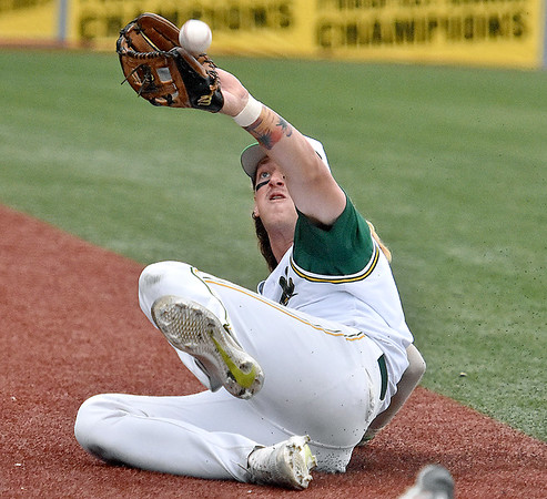 (Brad Davis/The Register-Herald) Miners 3rd baseman John Hagan makes a spectacular sliding catch in foul territory during the Miners' game one division series loss to the Blue Sox Sunday night at Linda K. Epling Stadium.