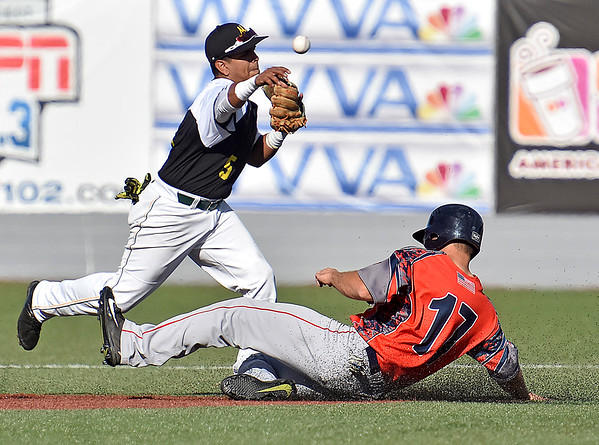 (Brad Davis/The Register-Herald) Miners shortstop Edwin Bonilla forces out Chillicothe's Dalton Bollinger for the first out of a 4-6-3 double play Sunday afternoon at Linda K. Epling Stadium.