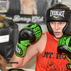 (Brad Davis/The Register-Herald) Toughman Contest fighter Amber Sweeney, the 2013 Beckley runner-up and champion of this year's Huntington event in January, spars with Lewisburg resident and two-time Toughman champion Candie Benedict Monday evening at the Mount Hope Boxing Club. Sweeney, like many fighters with serious ambitions of taking home a title, has been training with Carl Murdock three days a week to get ready for a tough division that features last year's champ Sarah Coffey.