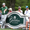 Golfers, spectators and volunteers on the 12th tee box during the first round of The Greenbrier Classic.<br /> (Rick Barbero/The Register-Herald.com
