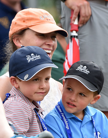 Brooks Brady, of New Bern, NC, enjoying the play of the second round of the Greenbrier Classic  with her two sons, Jake, 6 and Hudson, 4 from the 17th green.<br /> (Rick Barbero/The Register-Herald)