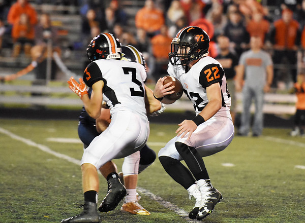 Richwood's Jeremiah Johnston (22) looks to carry  during their high school football game against Nicholas County Friday in Summersville. (Chris Jackson/The Register-Herald)