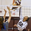 (Brad Davis/The Register-Herald) Woodrow Wilson's Asya Stewart spikes the ball as Capital's Hannah Spruce tries to block it during the Shirley Brown Invitational Volleyball Tournament Saturday afternoon at Woodrow Wilson High School.