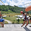 "(Brad Davis/The Register-Herald) Girls scouts are caught by workers Spencer Horn, right, and Ihell ""Panda"" Palermo as they man the landing tower of one of the zip lines at the Girl Scout Jamboree Saturday afternoon at the Bechtel Summit Reserve."