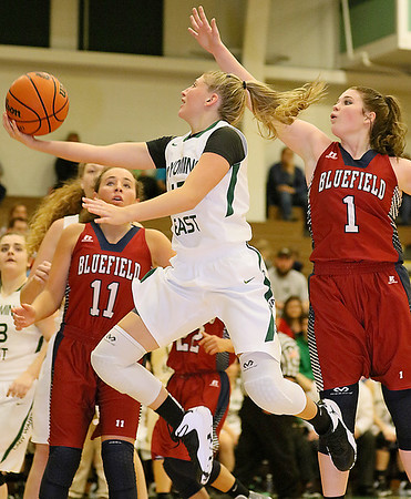 (Brad Davis/The Register-Herald) Wyoming East's Misa Quesenberry drives to the basket as Bluefield's Autumn Spangler (#1) tries to stop her Wednesday night in New Richmond.