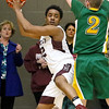 (Brad Davis/The Register-Herald) Woodrow Wilson's Breland Walton looks for an open teammate after pulling down an offensive rebound as Greenbrier East's Seth Brown defends during the Flying Eagles' Sectional Championship victory over the Spartans Friday night at the Beckley-Raleigh County Convention Center.