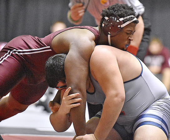 (Brad Davis/The Register-Herald) Woodrow Wilson's Tyree Swafford takes on Independence's Bowdy Boyce in a heavyweight class matchup during the West Virginia Army National Guard Duals Friday afternoon at the Beckley-Raleigh County Convention Center. Woodrow's Swafford would pin Boyce for the win.