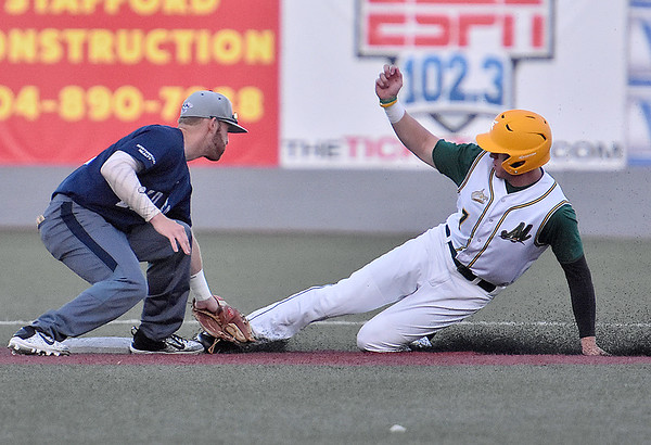 (Brad Davis/The Register-Herald) Miners baserunner Austin Norman is tagged out by Butler shortstop Tyler Benson after a perfect throw from catcher Kristian Webb to cut down the steal attempt Friday night at Linda K. Epling Stadium.