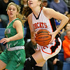 (Brad Davis/The Register-Herald) Summers County's Hannah Taylor drives to the basket past Charleston Catholic's Maddie Blaydes during the Lady Bobcats' win over the Irish Saturday night in Hinton.