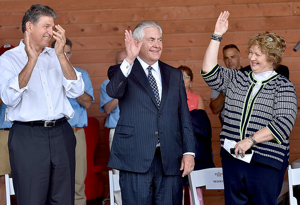 (Brad Davis/The Register-Herald) Senator Joe Manchin, Rex Tillerson and his wife Renda St. Clair during opening ceremonies for the visiting United States Secretary of State Friday at the Bechtel Summit Reserve.