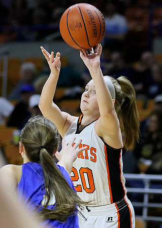 (Brad Davis/The Register-Herald) Summers County's Tiffani Cline shoots from three-point range as St. Joseph Central's Dena Jarrells steps up to defend Friday afternoon at the Charleston Civic Center.