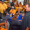 (Brad Davis/The Register-Herald) West Virginia men's basketball coach Bob Huggins receives a warm welcome from Mountaineer faithful as he enters the dining room area of Calacino's during the opening moments of the WVU Coaches' Caravan Thursday evening.
