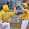 (Brad Davis/The Register-Herald) Miners baserunner Justin Mitchell, right, is greeted by teammates after coming in to score the third run of a three-run triple off the bat of teammate Austin Norman during the bottom of the 3rd inning Friday night at Linda K. Epling Stadium.