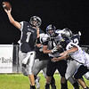 (Brad Davis/The Register-Herald) Westside quarterback Travis Cook throws Friday night in Clear Fork.
