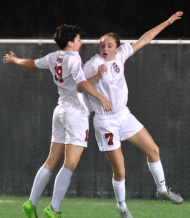 (Brad Davis/The Register-Herald) Cabell Midland players Logan Ward, left, and Emilie Charles celebrate their second and eventual game winning goal against Greenbrier East during Class AAA Girls State Soccer Tournament action Friday night the YMCA Paul Cline Memorial Sports Complex.