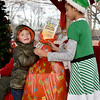 "(Brad Davis/The Register-Herald) Six-year-old Landon Adkins reacts as he receives a massive bundle of Christmas gifts from young volunteer elf Brooklyn Minnix, 10, during the 4th annual "" Santa at the Lighthouse"" event Saturday evening on the grounds of the Summersville Lake Retreat. This year the sponsored school was Zela Elementary, where students in grades K-2nd were invited to meet Santa and Mrs. Claus, have some hot chocolate and receive bundles of gifts they otherwise wouldn't be able to enjoy."