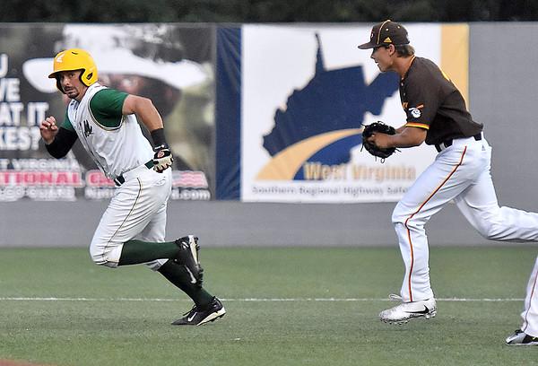 (Brad Davis/The Register-Herald) Miners baserunner Chris Simon is caught in a rundown as Kokomo starting pitcher Matthew Herman chases him Friday night at Linda K. Epling Stadium.