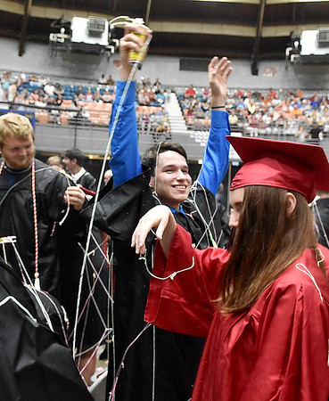 (Brad Davis/The Register-Herald) Liberty seniors erupt in celebration at the conclusion of the school's 40th Commencement Saturday morning at the Beckley-Raleigh County Convention Center.