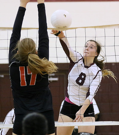 (Brad Davis/The Register-Herald) Woodrow Wilson's Bryce Knapp tries to make a kill as St. Albans' Macayla Thornburgh tries to block it Saturday afternoon at Woodrow Wilson High School.