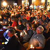 (Brad Davis/The Register-Herald) Congregants and town residents look on with their candles alight at the conclusion of Rainelle United Methodist's 2016 flood memorial service Friday night.