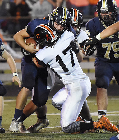 Nicholas County quarterback Jared Sagraves (2) is sacked by Richwood's Hunter King (17) during their high school football game Friday in Summersville. (Chris Jackson/The Register-Herald)