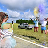 (Brad Davis/The Register-Herald) Morgan Walls, left, photographs Taylor Newman, right, and Destiney Bert on a smartphone follwing the United Way of Southern West Virginia's annual Color Me United Walk/Run Saturday morning at the Raleigh County Memorial Airport.