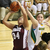 (Brad Davis/The Register-Herald) Woodrow Wilson's Brennah Staunton drives and scores as Greenbrier East's Morgan Amos defends during Big Atlantic Classic action Thursday night at the Beckley-Raleigh County Convention Center.