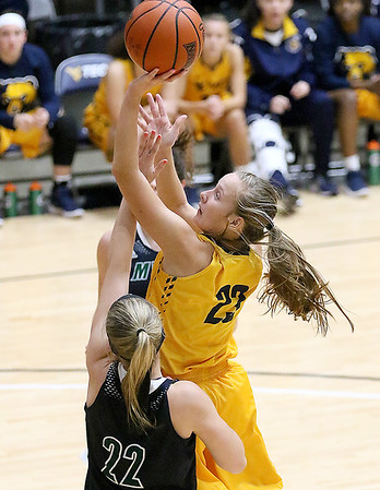 (Brad Davis/The Register-Herald) WVU Tech's Brittney Justice drives and scores between Mount Vernon Nazarene's Sierra Basista defends Tuesday night at the Beckley-Raleigh County Convention Center.