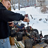 (Brad Davis/The Register-Herald) 14-year-old Joe Watson turns his front porch into a mini garage area as he tries to get a couple of his much more powerful and faster gas powered 1/8 scale R.C. cars to run in the bitter cold Sunday afternoon at his Wyco Hollow Road home.