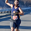 (Brad Davis/The Register-Herald) Top male finisher Andrew Barbera makes his way down the home stretch during the YMCA of Southern West Virginia's annual Turkey Trot 5K Walk/Run on a chilly Thanksgiving morning Thursday at the YMCA Paul Cline Memorial Sports Complex.