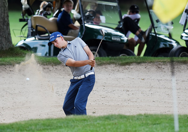 Landon Perry chips onto the No. 17 green of The Cobb course during the championship round of the annual BNI Tournament Monday at The Resort at Glade Springs. (Chris Jackson/The Register-Herald)