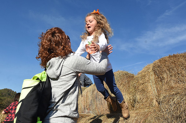 Lauren Dillon. parent volunteer, left, catches Jenna Fitzwater, Pre-K student, after she jumped off the hay tunnels at Okes Family Farm in Cool Ridge. Crescent Elementary Pre-K spent the day at the farm. participating in the hay tunnels, corn maze, corn box, tractor ride to pumkin patch and the jump house. Oke's Family Farm is open during the week for school field trips and open to the public, Saturday 10 am to 5:30 p.m. and Sunday noon to 5:30 p.m.<br /> (Rick Barbero/Rick Barbero/The Register-Herald)