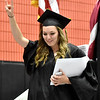 (Brad Davis/The Register-Herald) Summers County High School graduate Bryanna Bragg gestures to the crowd after collecting her diploma during the school's commencement ceremony Friday evening in Hinton.