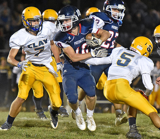 (Brad Davis/The Register-Herald) Independence's Connor Gibson dodges Clay County defender Nathan Canfield (#5) as he carries the ball Friday night in Coal City.