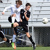 Jarred Johnson, of Pikeview, left, and Ian Bibb, of Oak Hill, go after the ball during the sectional final match held at the YMCA Paul Cline Memorial Youth Sports Complex. <br /> (Rick Barbero/The Register-Herald)