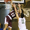 (Brad Davis/The Register-Herald) Virginia Episcopal's Jaelin Llewellyn sticks a one-handed, high-flying dunk despite a hard foul from First Love Christian's Mohamed Selmi during the opening night of the Battle for the Armory Basketball Tournament Thursday night at the Beckley-Raleigh County Convention Center.