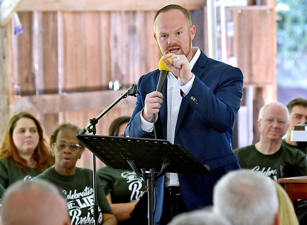 (Brad Davis/The Register-Herald) Rev. Chad Dingess delivers a passionate message during White Sulphur Springs' Service of Life & Rebirth Sunday afternoon in the new Brad Paisley Park.