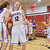 (Brad Davis/The Register-Herald) Midland Trail teammates Brianna Ruffner, left, and Mickie Hypes share an encouraging handshake and shoulder bump as she's introduced by the public address announcer prior to their opening round game against Valley (Fayette) in the Region 3, Section 1 tournament Saturday evening at Oak Hill High School.