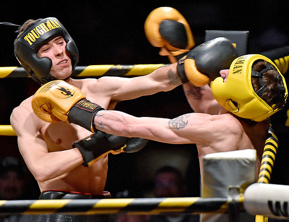 (Brad Davis/The Register-Herald) Beckley's Dennis Adkins connects with a left on Shady Spring's Jessie Wood during Original Toughman action Saturday night at the Beckley-Raleigh County Convention Center. Adkins would win the fight.